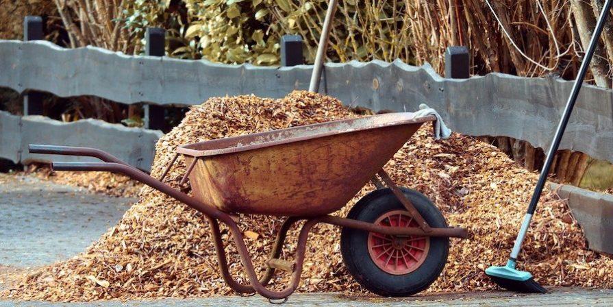 Wheelbarrow In Front Of Mulch