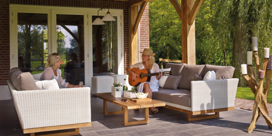 Two Women on Patio Furniture with Guitar