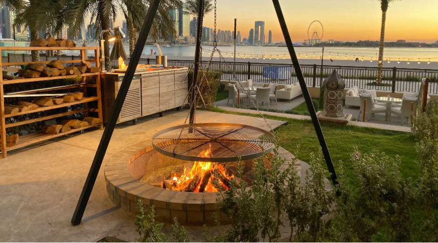 firepit with skyline in background