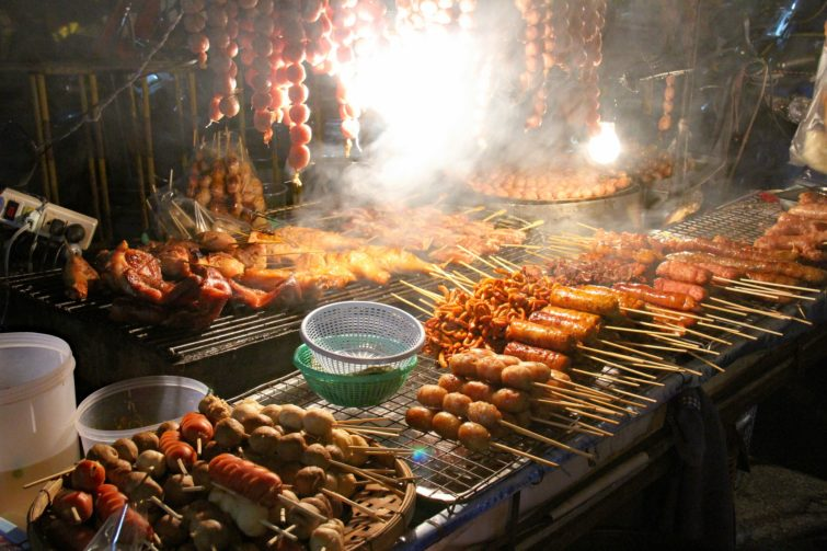 A barbecue full of meat at night