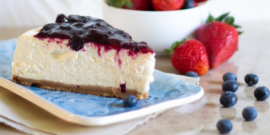 Blueberry cheesecake on a blue plate