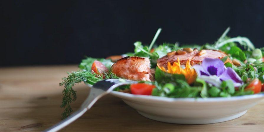 fork resting on a bowl of salad