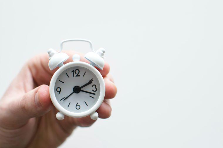 little white alarm clock