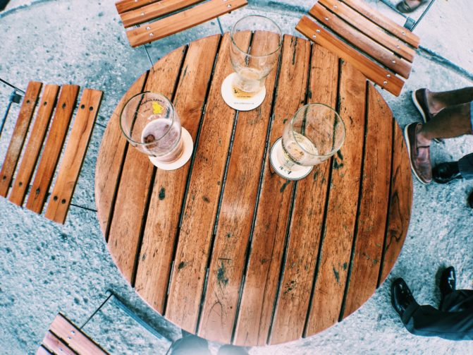 wooden backyard bar with three bottles on the table