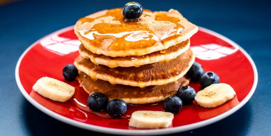 Blueberry pancakes on a red plate