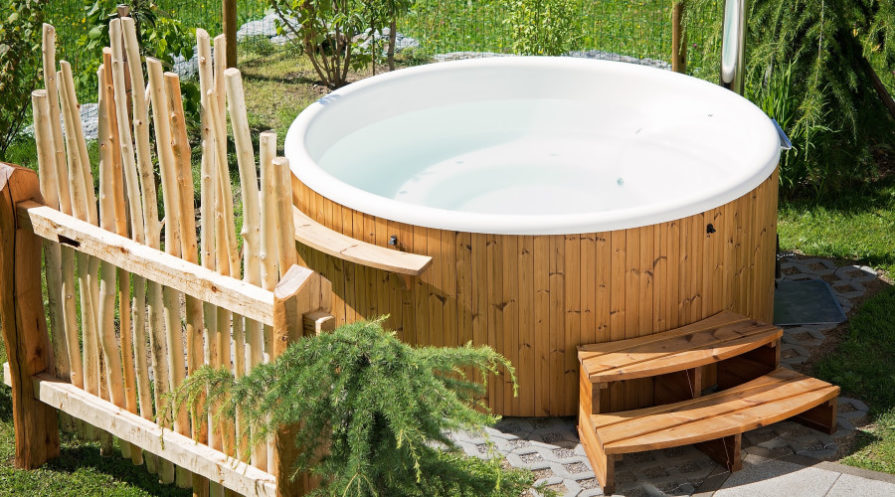 wooden hot tub with fence and steps