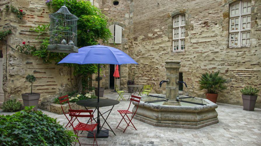 Blue Patio Umbrella next to the fountain