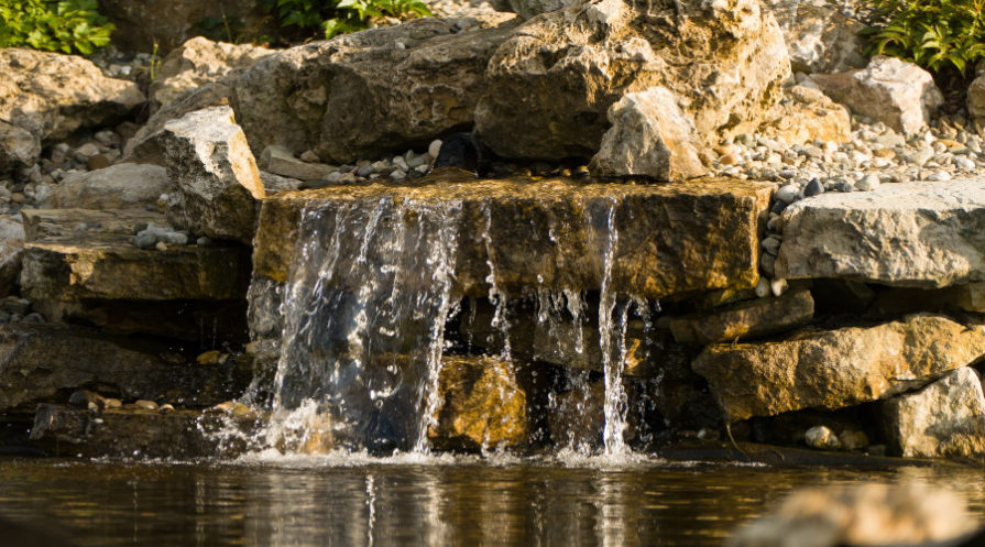 Pond waterfall made of stone