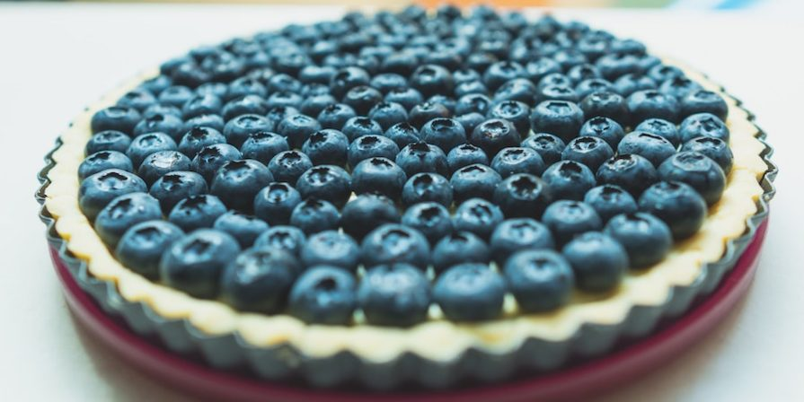 Pie with blueberries on top