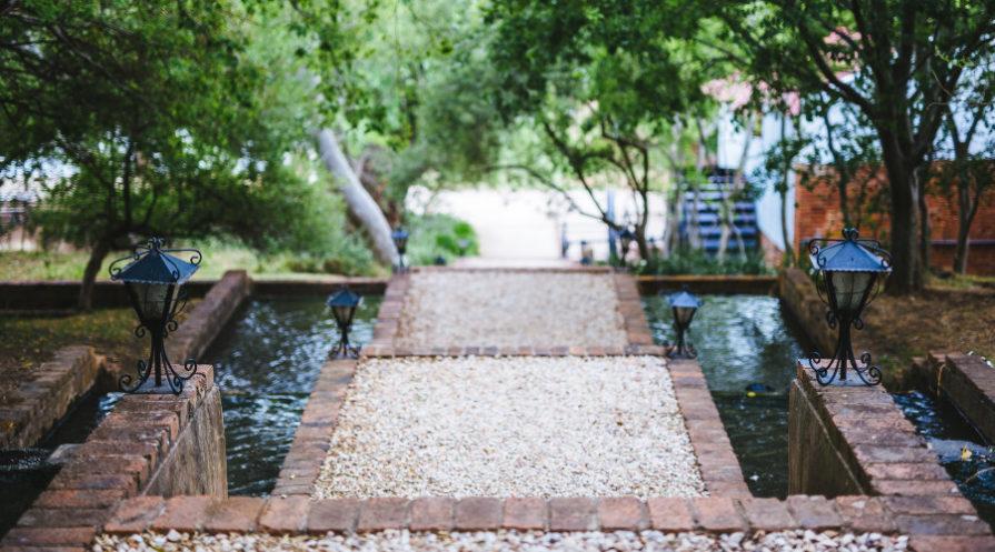 pond split by a walking path