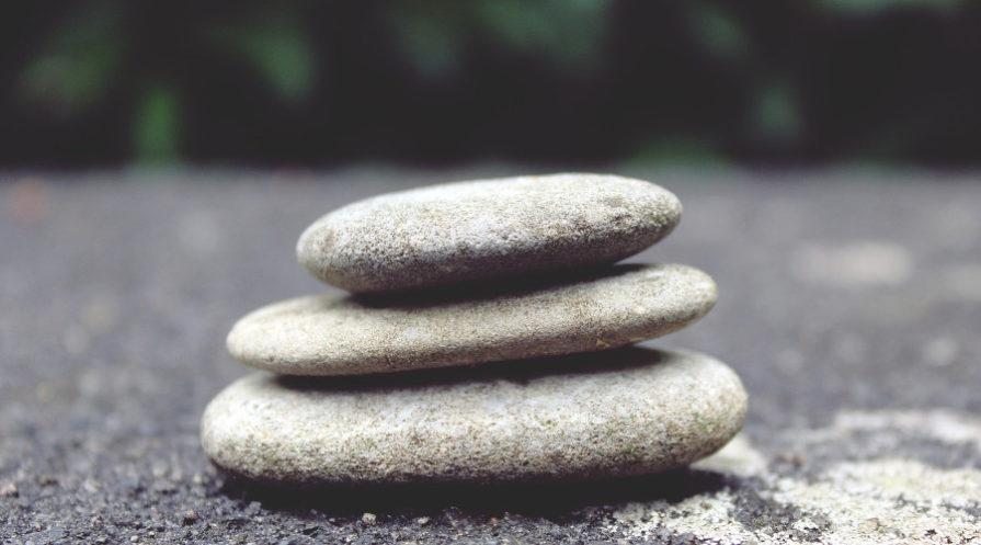 stones stacked in a zen garden