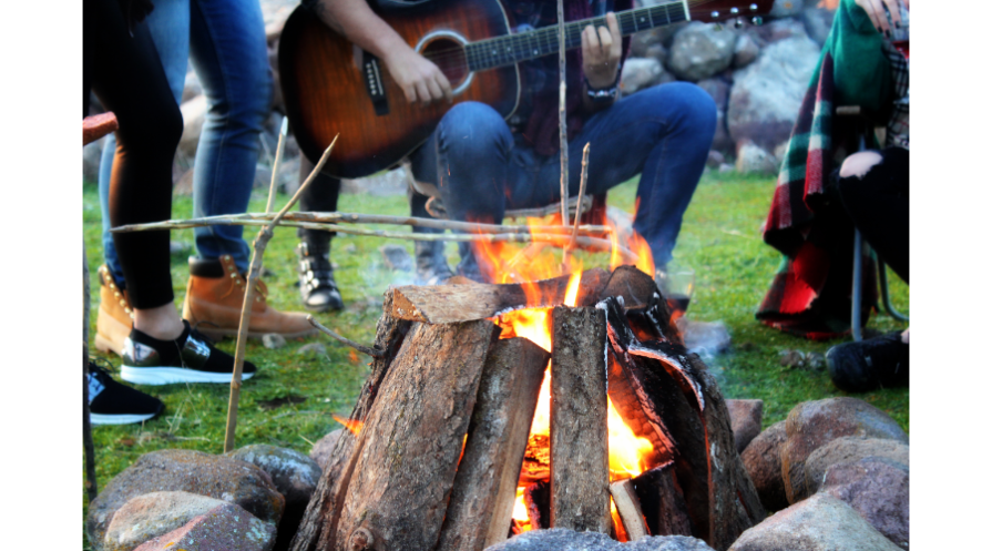 campfire with guy playing guitar