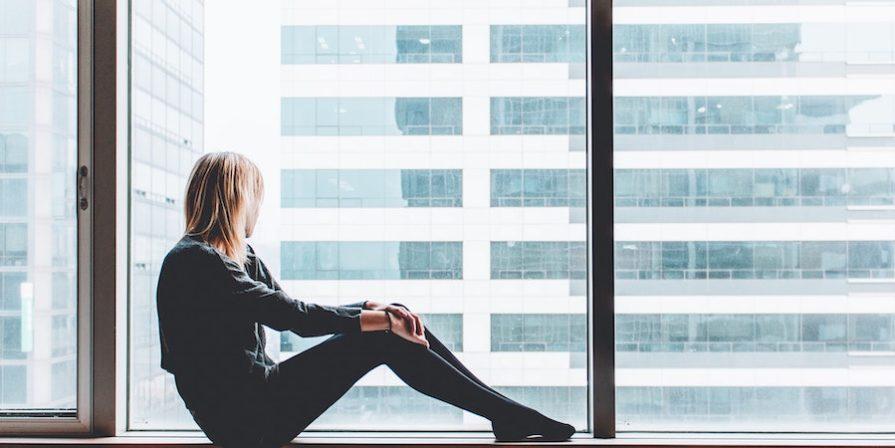 Lady sitting on window sill