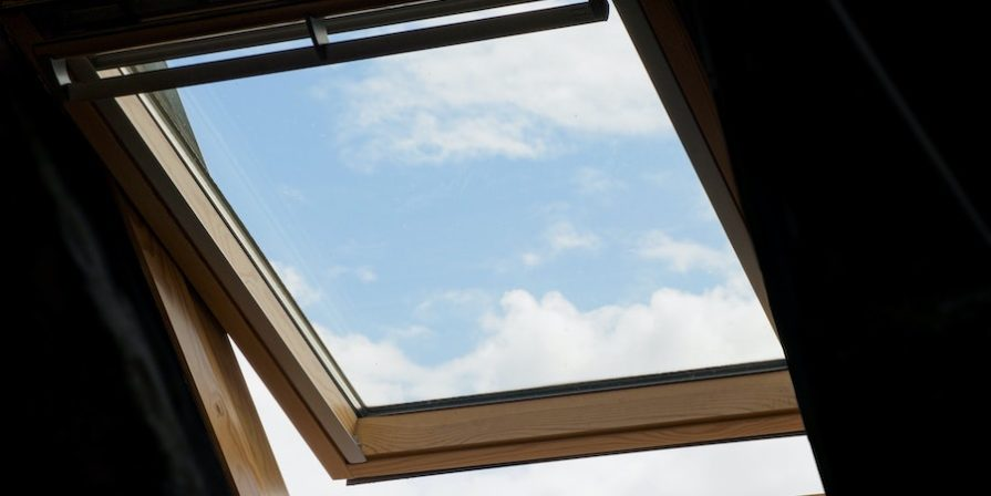 Open skylight with view of the sky