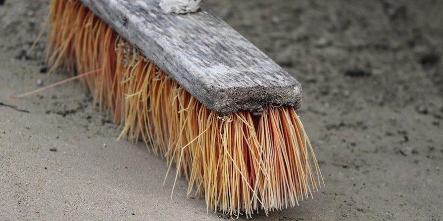 Yellow bristled broom on concrete