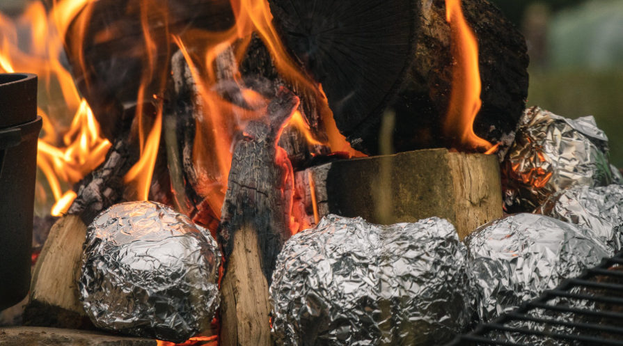 Potatoes wrapped in foil on campfire
