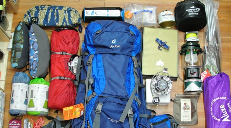 camping gear all displayed spread out across a wooden floor