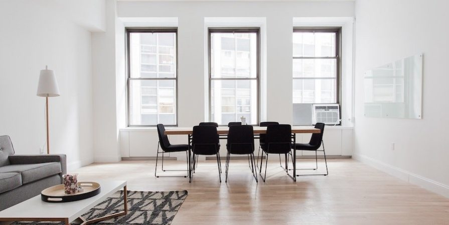 White room with table and chairs