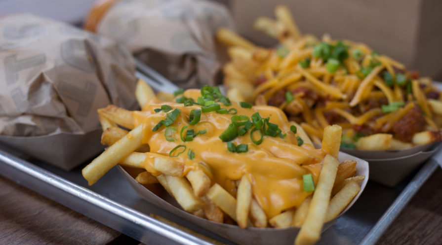 cheese fries topped with scallions