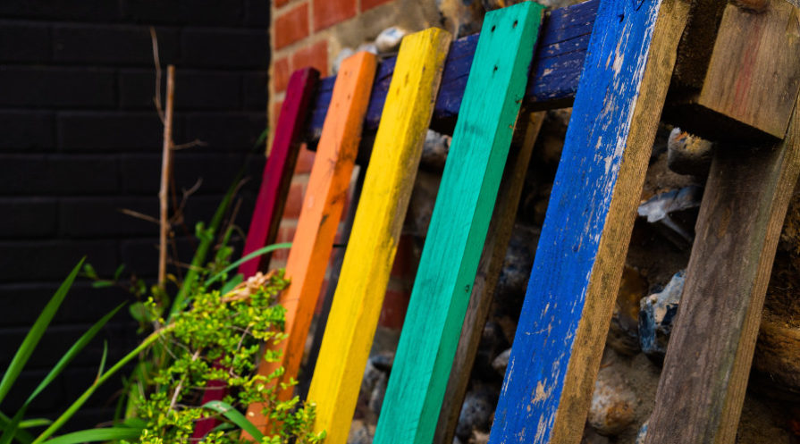 Colorful pallet leaning against wall