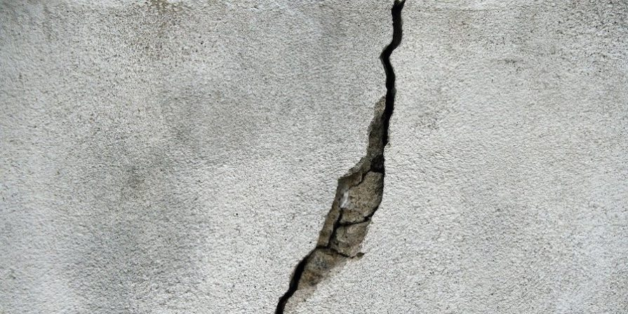 Deep crack in concrete surface