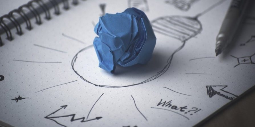 Ball of blue tape on a notepad