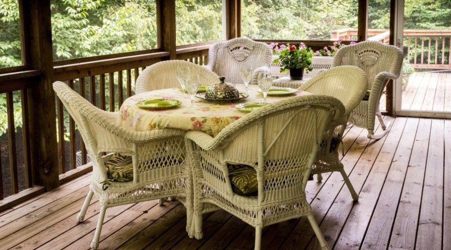Deck with wicker dining furniture set