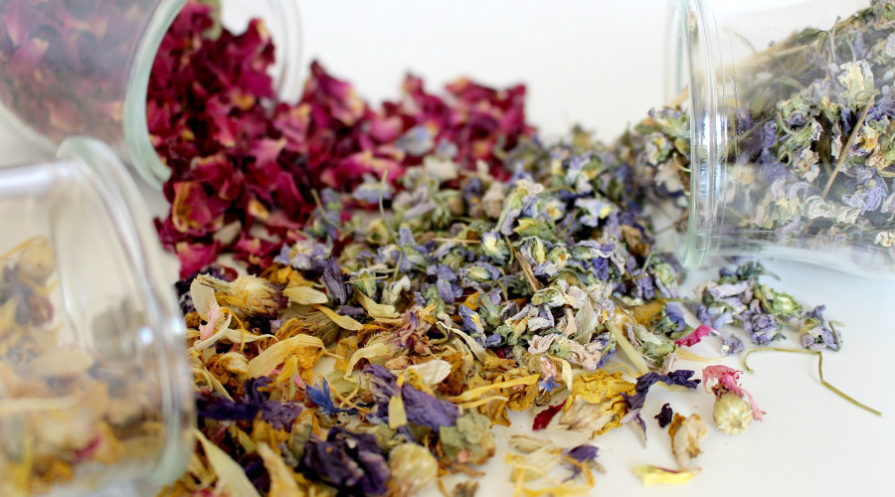 dehydrated flowers spilling from clear jars
