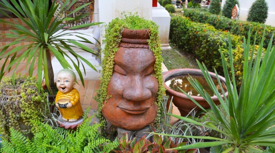 Unique planters and statuary around plants