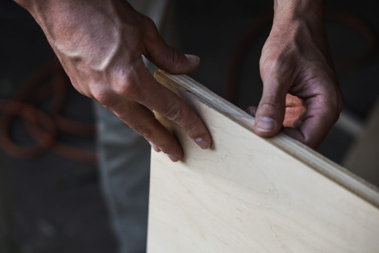 Man holding a plywood