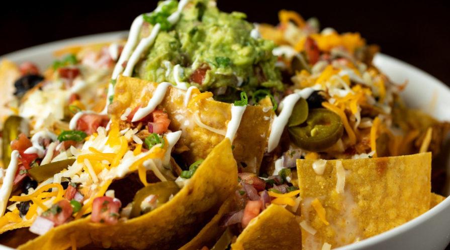 nachos in white bowl