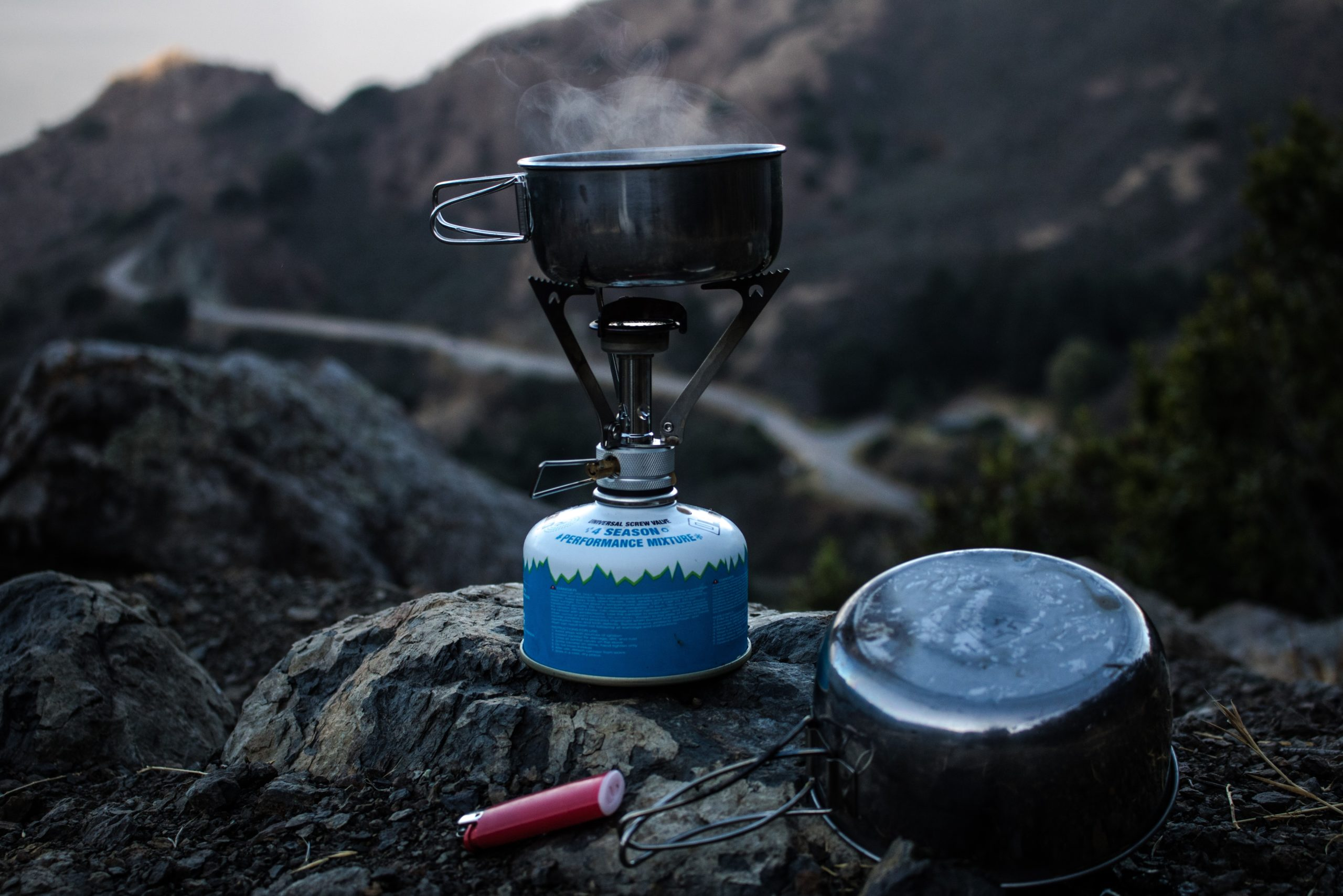 Blue camping stove on the rock in the mountains
