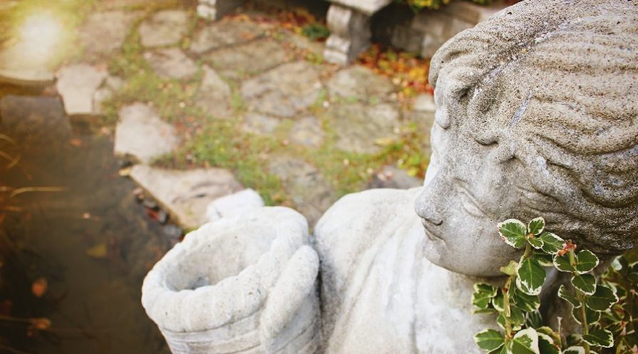Close up of statue of woman holding basket outdoors