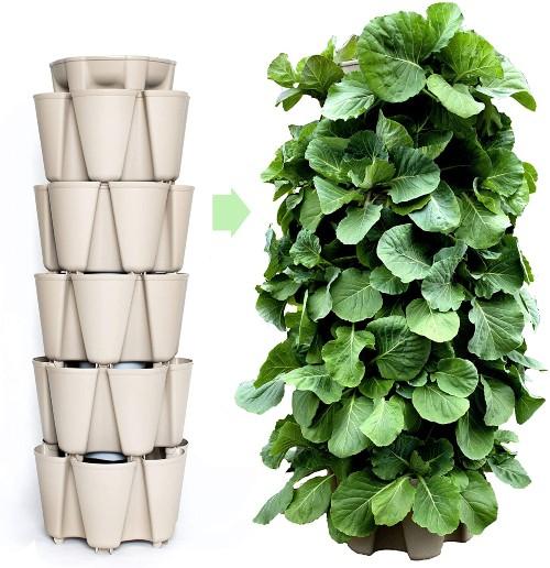 a cream coloured garden tower planter next to a fully grown garden tower planter