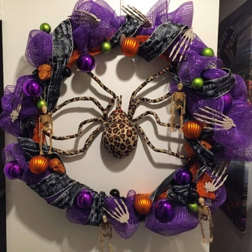 Purple burlap ribbon wreath with large spider in center