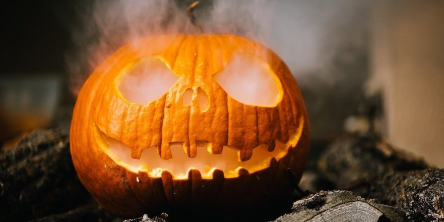 Carved pumpkin with smoke