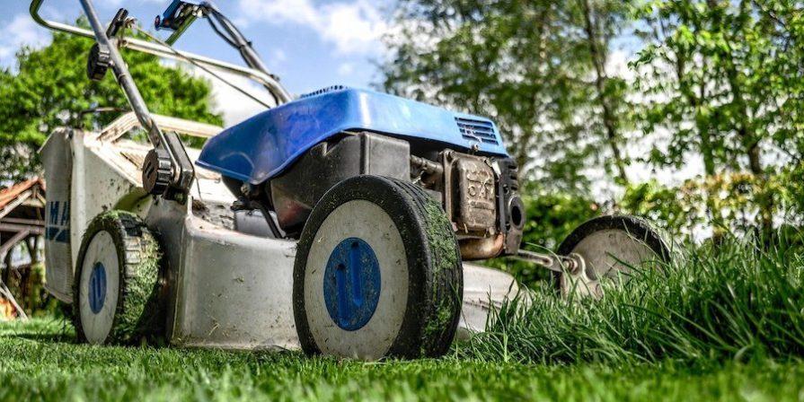 Blue mower cutting grass