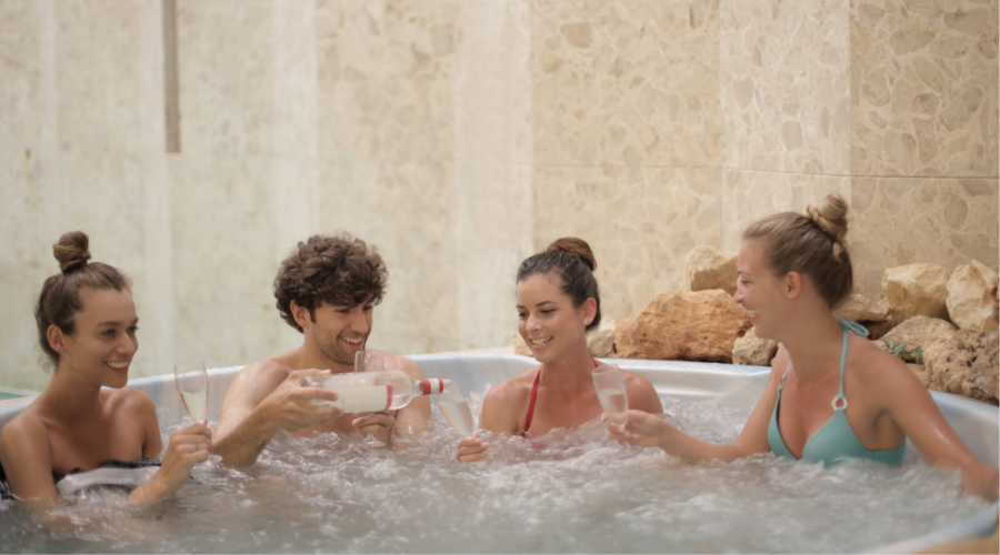 People having drinks in a hot tub