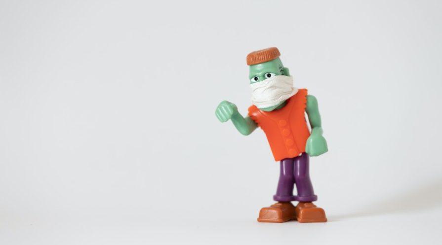 Mini Frankenstein's monster wearing a mask