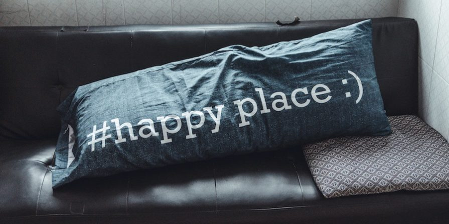 Black couch with #happyplace pillow