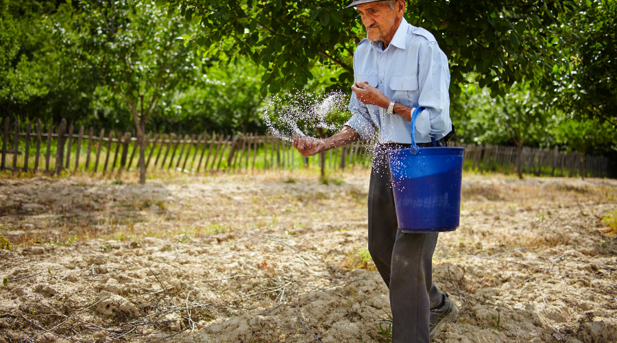 Man spreading fertilizer