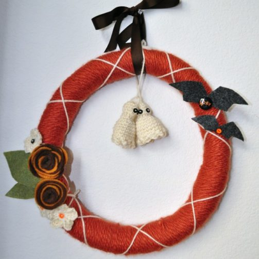 Yarn and felt Halloween wreath with miniature ghosts and bats