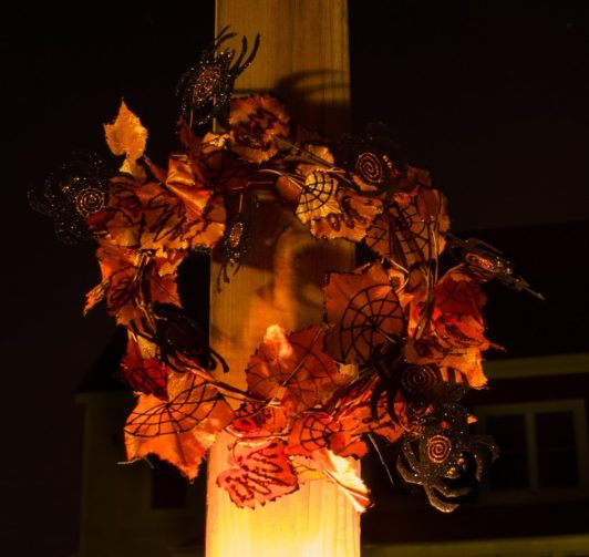 Halloween wreath with fall leaves and spiders
