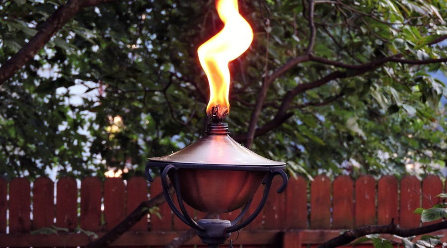 lit outdoor oil torch-style light