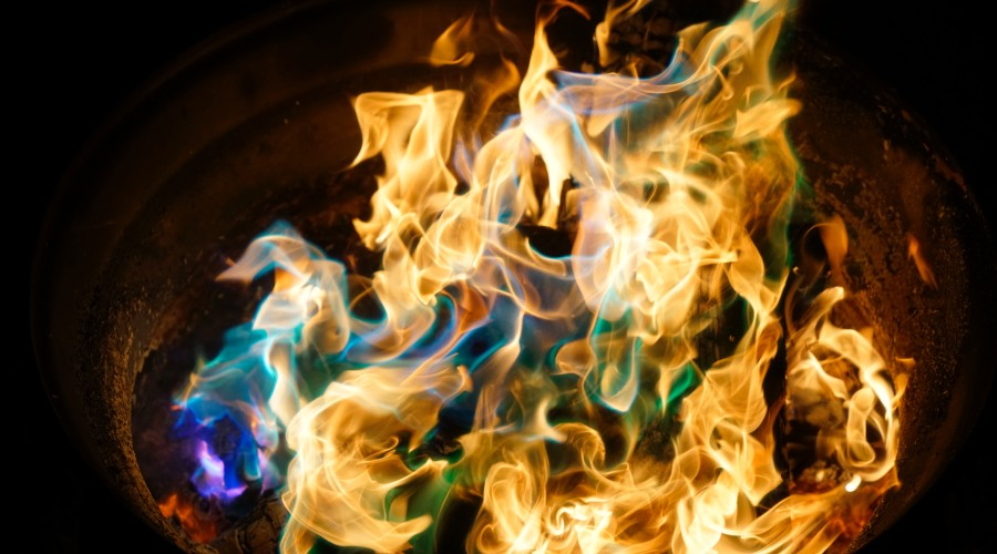 campfire flames with blue and green flames