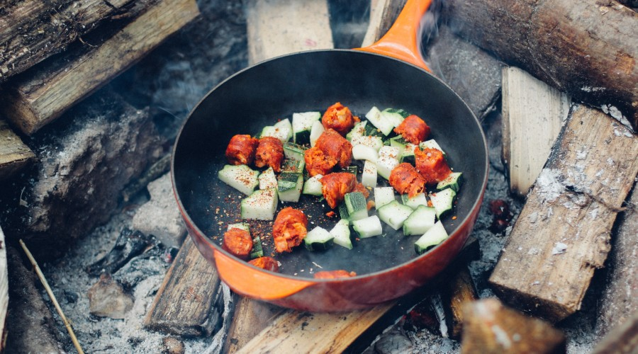 meat and vegetable on cooking pan over fire