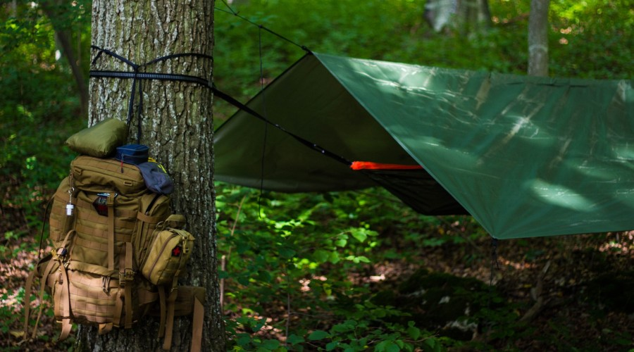 tarp strung up over a hammock to use as a tent
