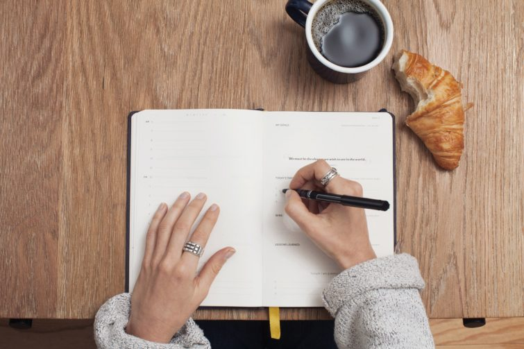 A person noting something in a diary