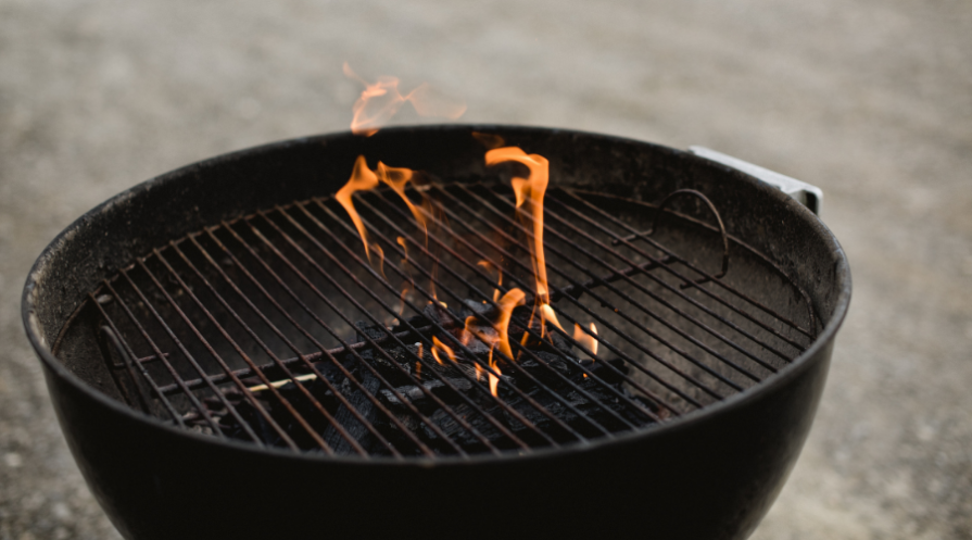 Lit charcoal grill