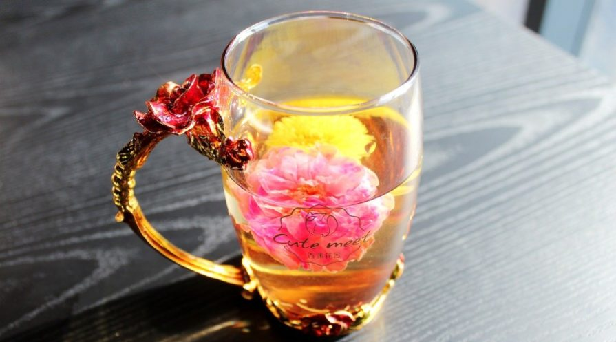 flowers floating in a tea cup